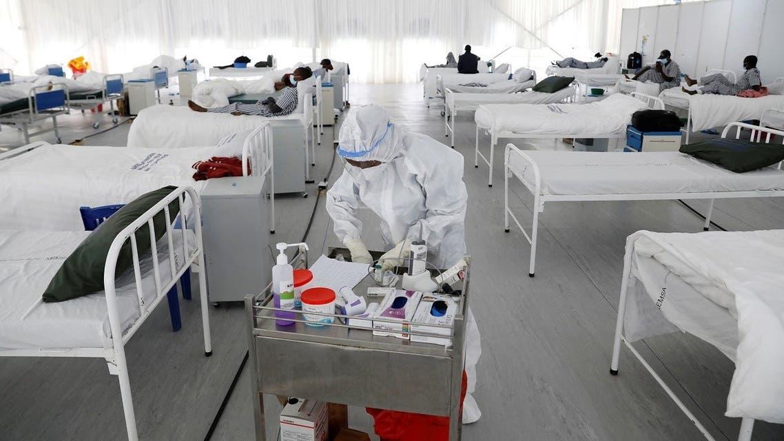 A nurse works inside a field hospital builtÊon a soccer stadium in Machakos, Kenya. (Reuters)