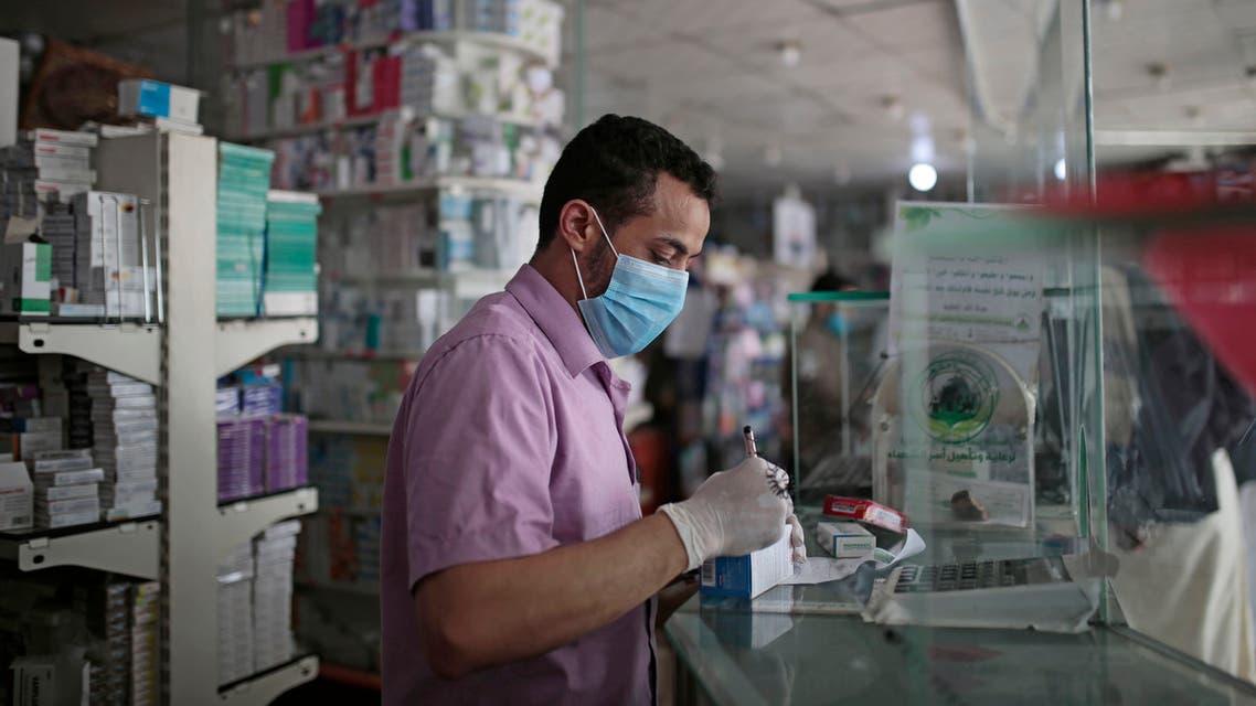 A Yemeni pharmacist at a pharmacy in Sanaa, Yemen on June 25, 2020. (File photo: AP)
