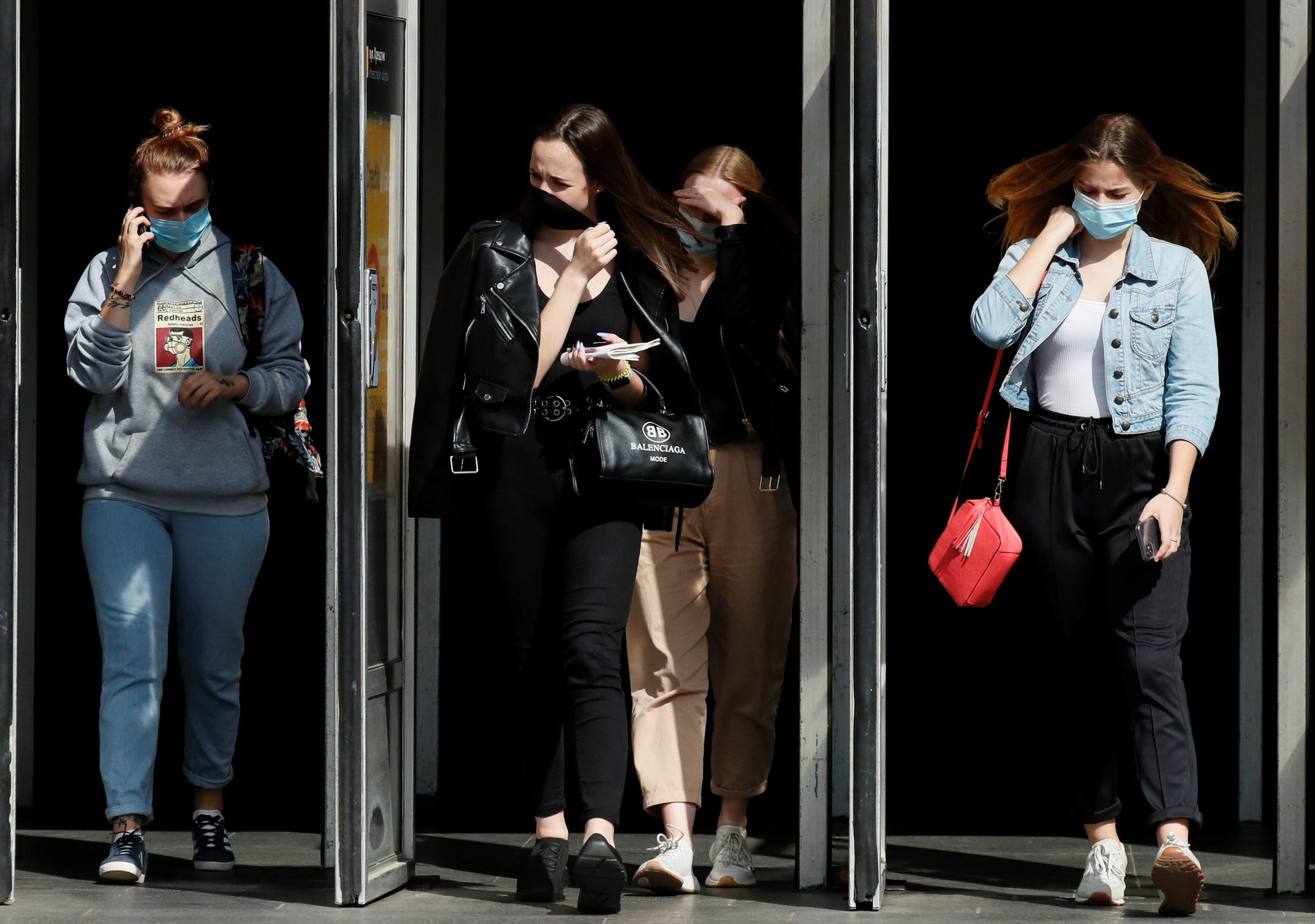 People wearing protective face masks amid the outbreak of the coronavirus disease (COVID-19) walk out of a metro station in Kyiv, Ukraine July 15, 2020. (File photo: Reuters)