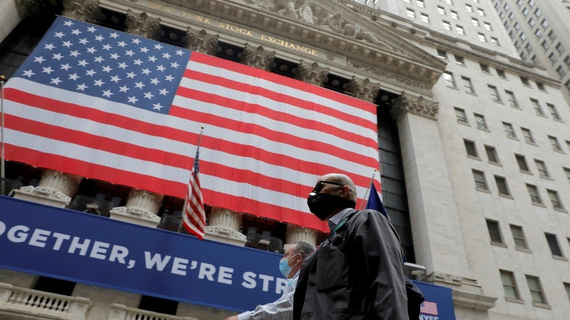 Traders walk past the New York Stock Exchange in the Manhattan borough of New York, US. (Reuters)