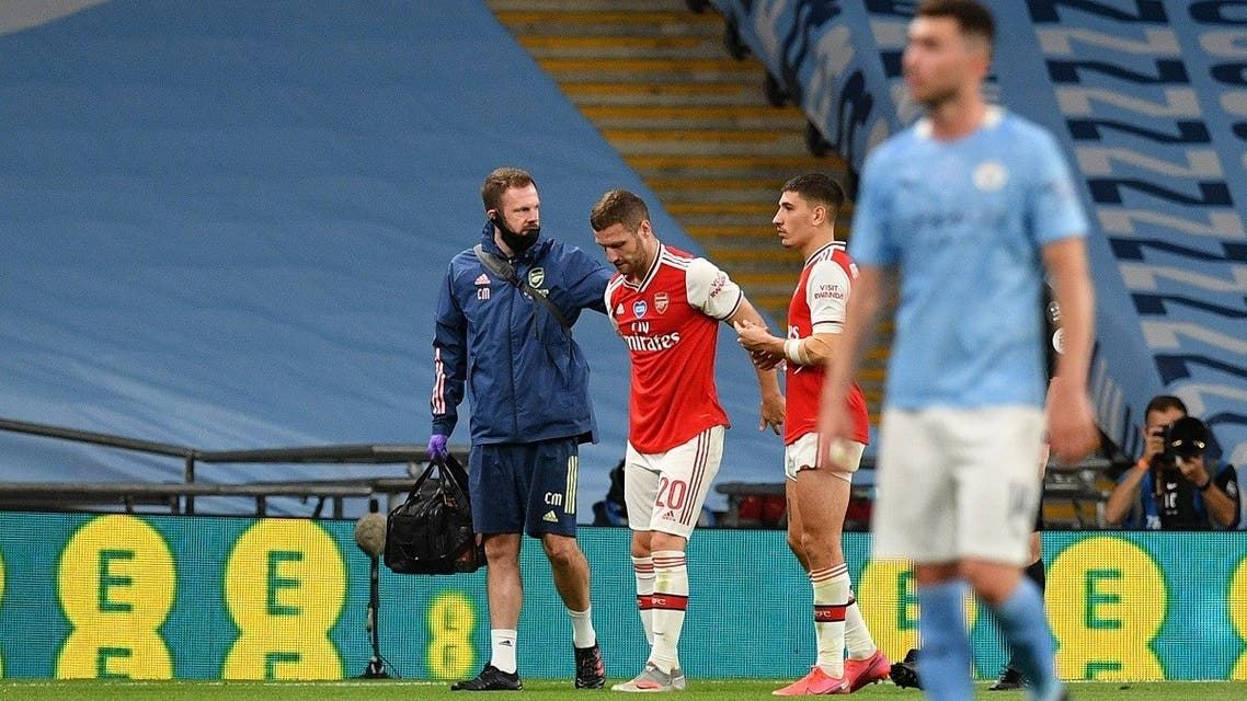 Arsenal's Shkodran Mustafi walks off to be substituted after sustaining an injury, during the FA Cup Semi Final against Manchester City at Wembley Stadium, London, Britain, on July 18, 2020. (Reuters)