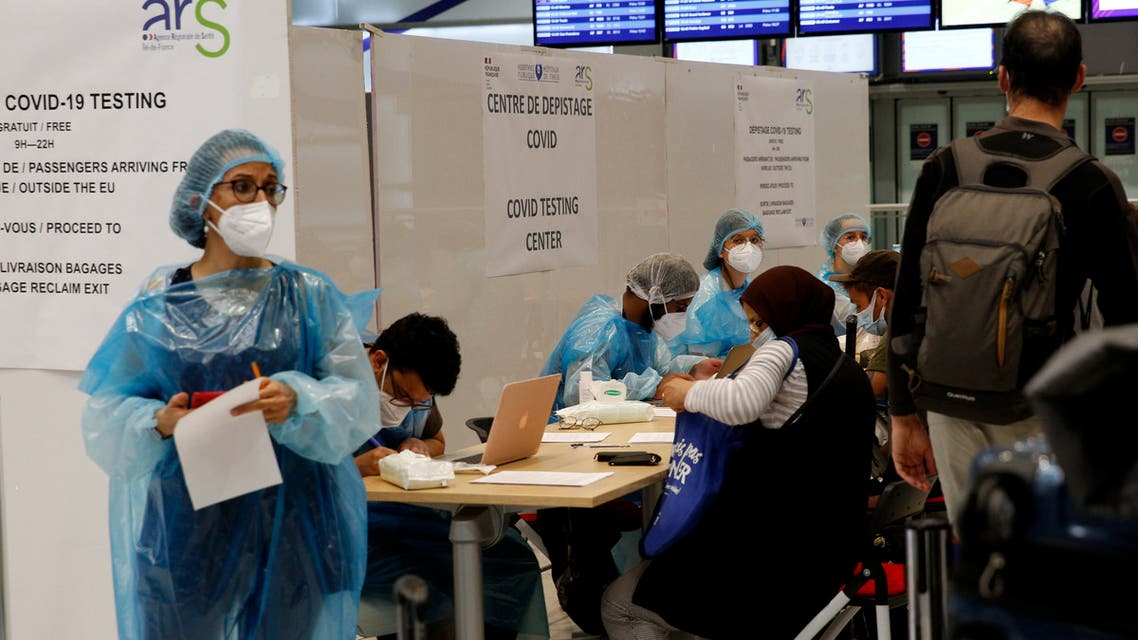 Medical staff take charge of passengers in a COVID-19 testing center north of Paris, on July 24, 2020. (AP)