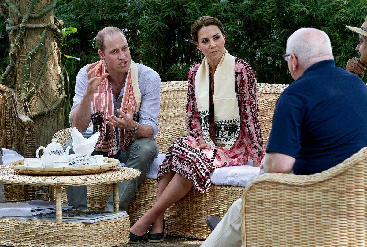 Britain's Prince William and his wife Kate, the Duchess of Cambridge talk to officials at the Centre for Wildlife Rehabilitation and Conservation (CWRC) at Panbari reserve forest in Kaziranga, east of Gauhati, northeastern Assam state, India, on April 13, 2016. (AP)