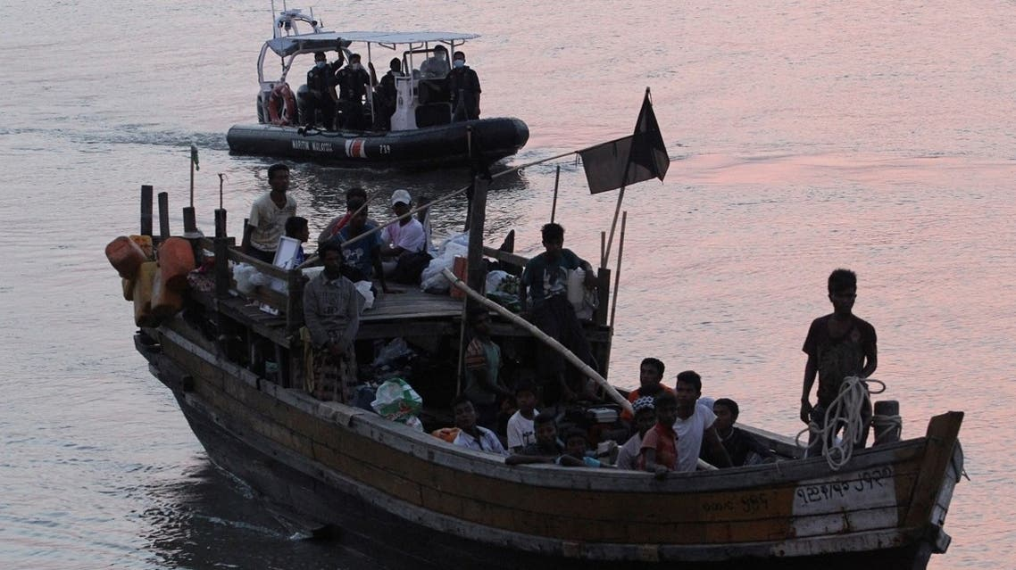 File photo of Rohingya refugees who were intercepted by Malaysian Maritime Enforcement Agency off Langkawi island, are escorted in their boat as they are handed over to immigration authorities, at the Kuala Kedah ferry jetty in Malaysia (Reuters).