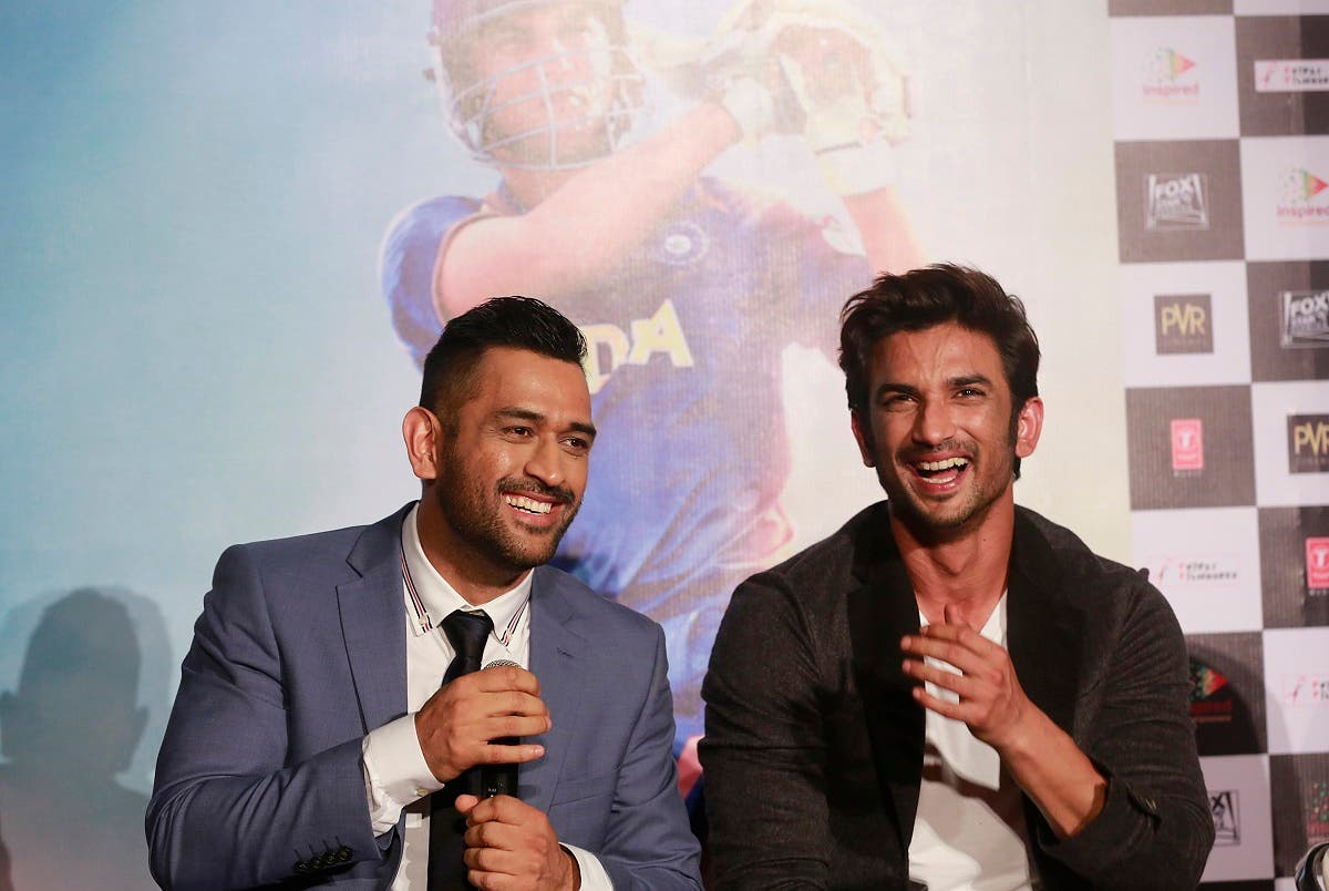 Indian cricketer Mahendra Singh Dhoni, left, shares a light moment with Bollywood actor Sushant Singh Rajput as they speak with the media during the trailer launch of upcoming movie 'MS Dhoni: The Untold Story' in Mumbai, India, Thursday, Aug 11, 2016. (AP)