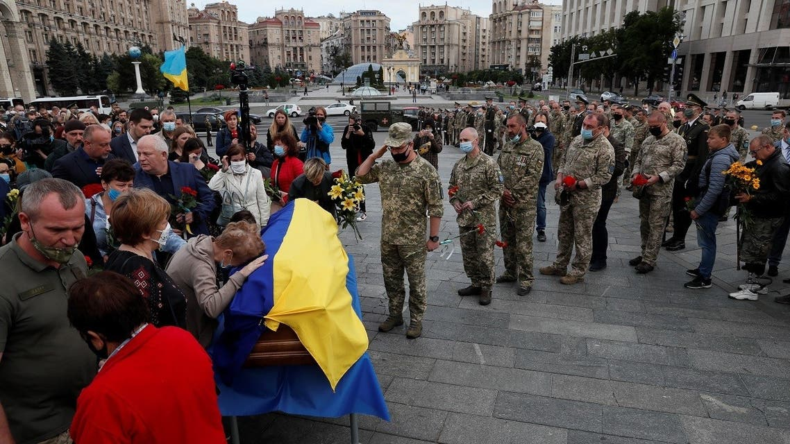 People pay their respects to Taras Matviyiv, a Ukrainian serviceman killed on July 10 in the fighting against pro-Russian separatists in the country's east, during a memorial service at the Independence Square in central Kyiv, Ukraine, on  July 14, 2020. (Reuters)