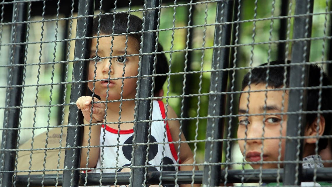 Children, part of a group of asylum seekers thought to be from China's Uighur minority, sit in a truck in Songkhla, southern Thailand on March 15, 2014. (AP)