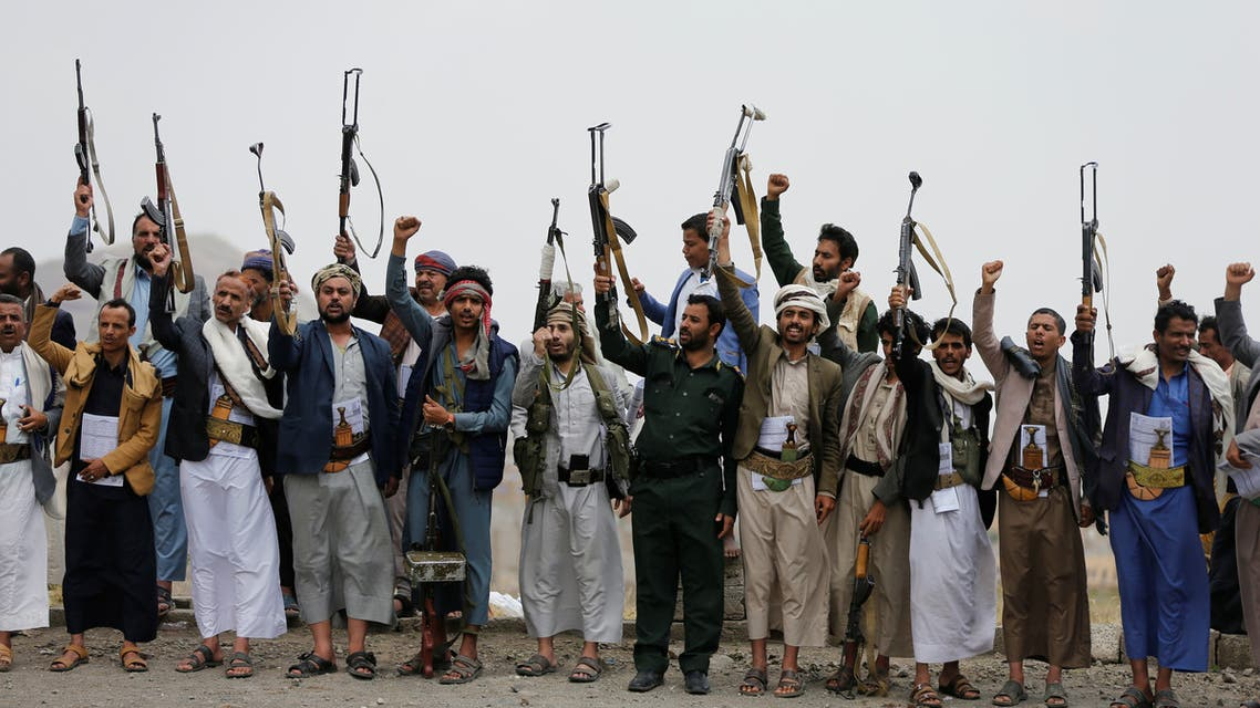 Tribesmen loyal to the Houthi group wave up their weapons as they shout slogans during a gathering of Houthi loyalists on the outskirts of Sanaa, Yemen July 8, 2020. REUTERS/Khaled Abdullah