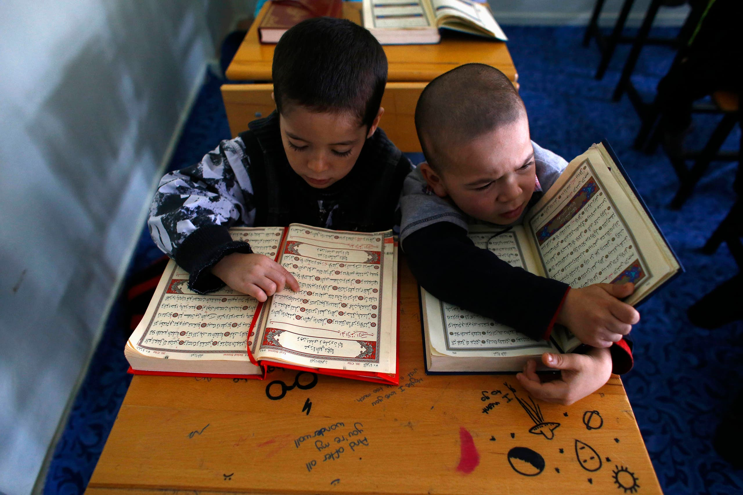Uighur refugee boys read the Koran where they are housed in a gated complex in the central city of Kayseri, Turkey, February 11, 2015. (File photo: AP)
