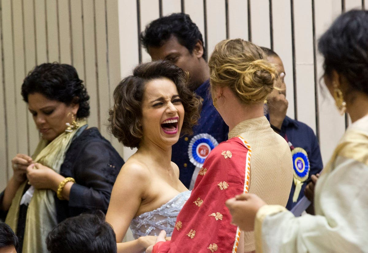 File photo of Bollywood actor Kangana Ranaut (center), gestures as she interacts with an unidentified person during the national film awards presentation ceremony in New Delhi, India. (AP)