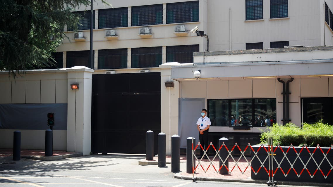 A member of security personnel stands guard in front of the former U.S. Consulate General with the signage and plaques covered with gray material in Chengdu, Sichuan province, China, July 27, 2020, after China ordered its closure in response to U.S. order for China to shut its consulate in Houston. (Reuters)