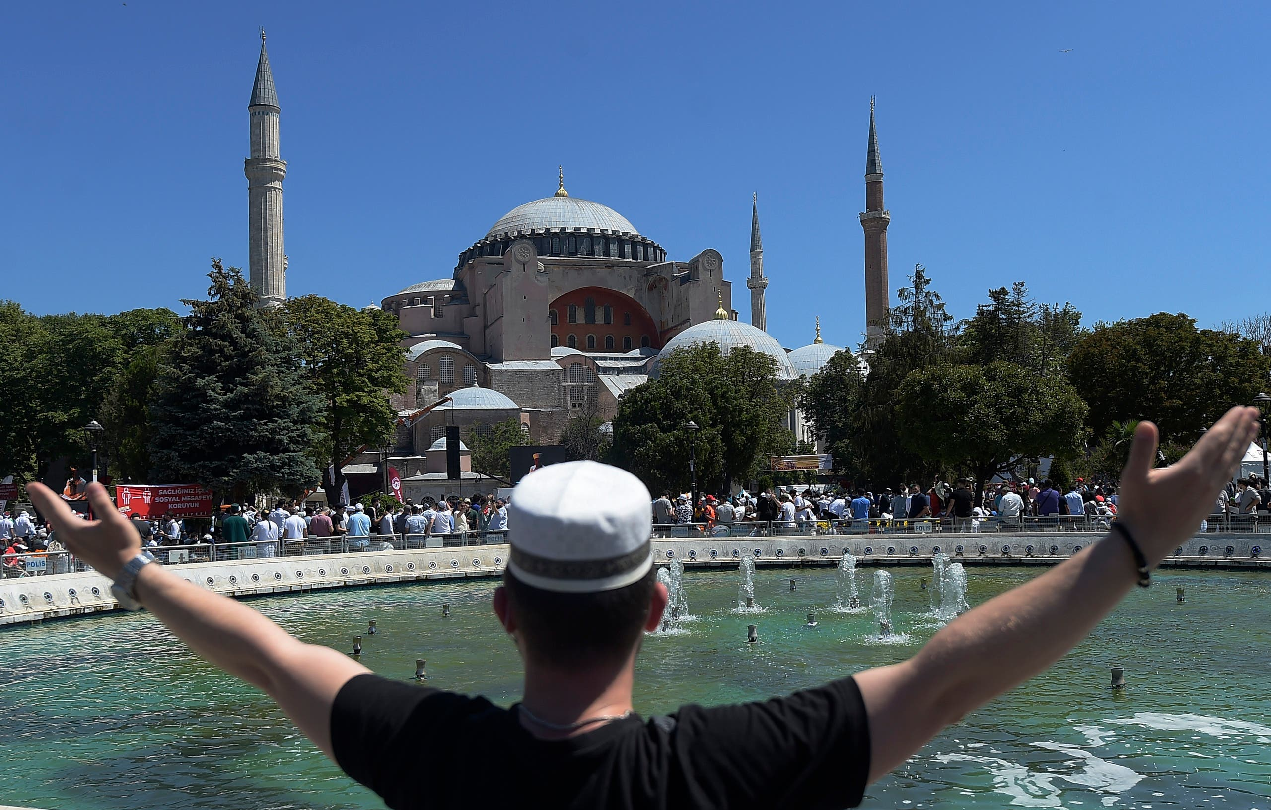 A youth gestures as he waits at the historic Sultanahmet district of Istanbul, outside the Byzantine-era Hagia Sophia on July 24, 2020. (AP)