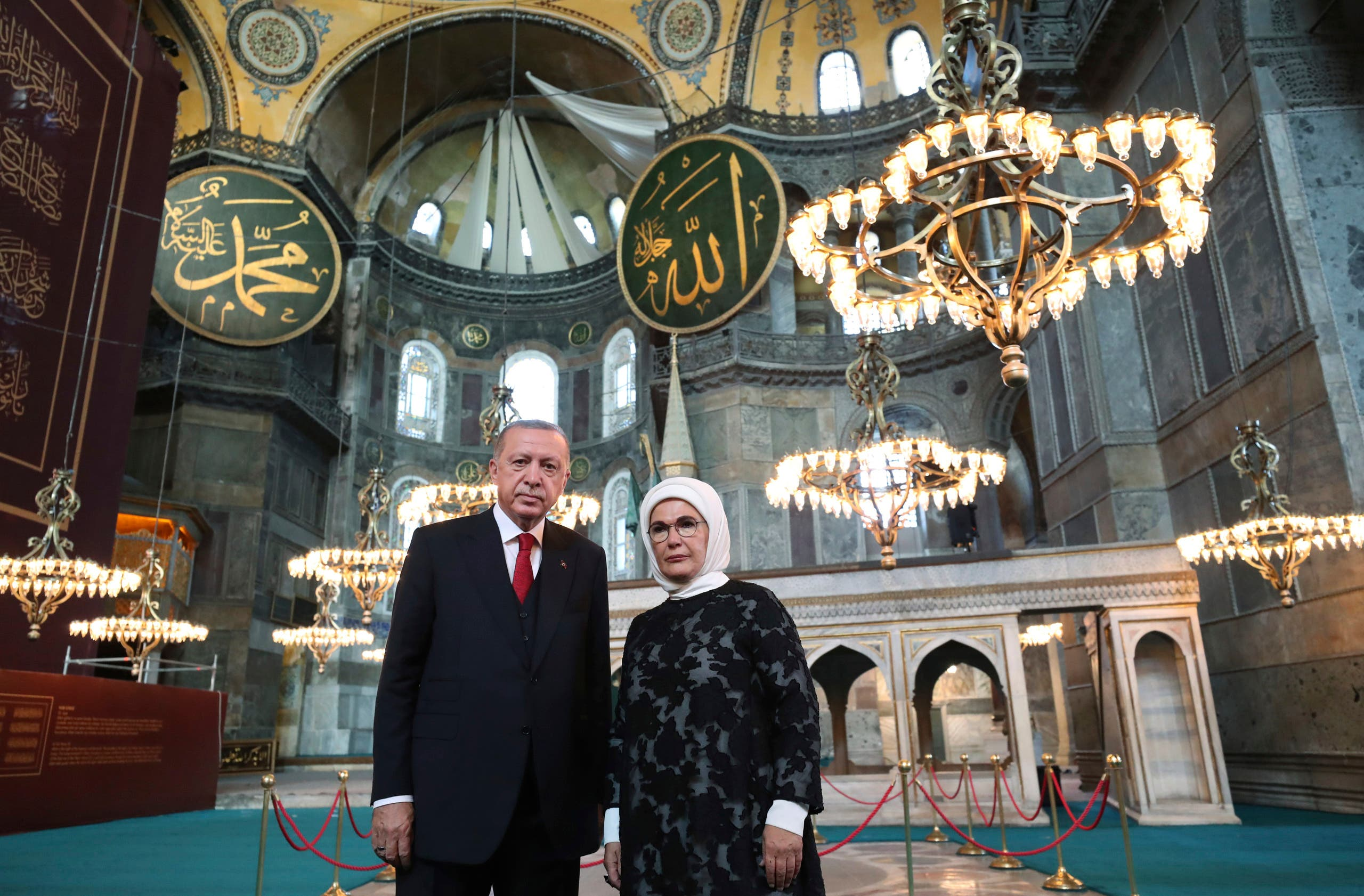 Turkey's President Recep Tayyip Erdogan, accompanied by his wife Emine, poses for photographs as he visits the Byzantine-era Hagia Sophia, in Istanbul on July 23, 2020. (AP)