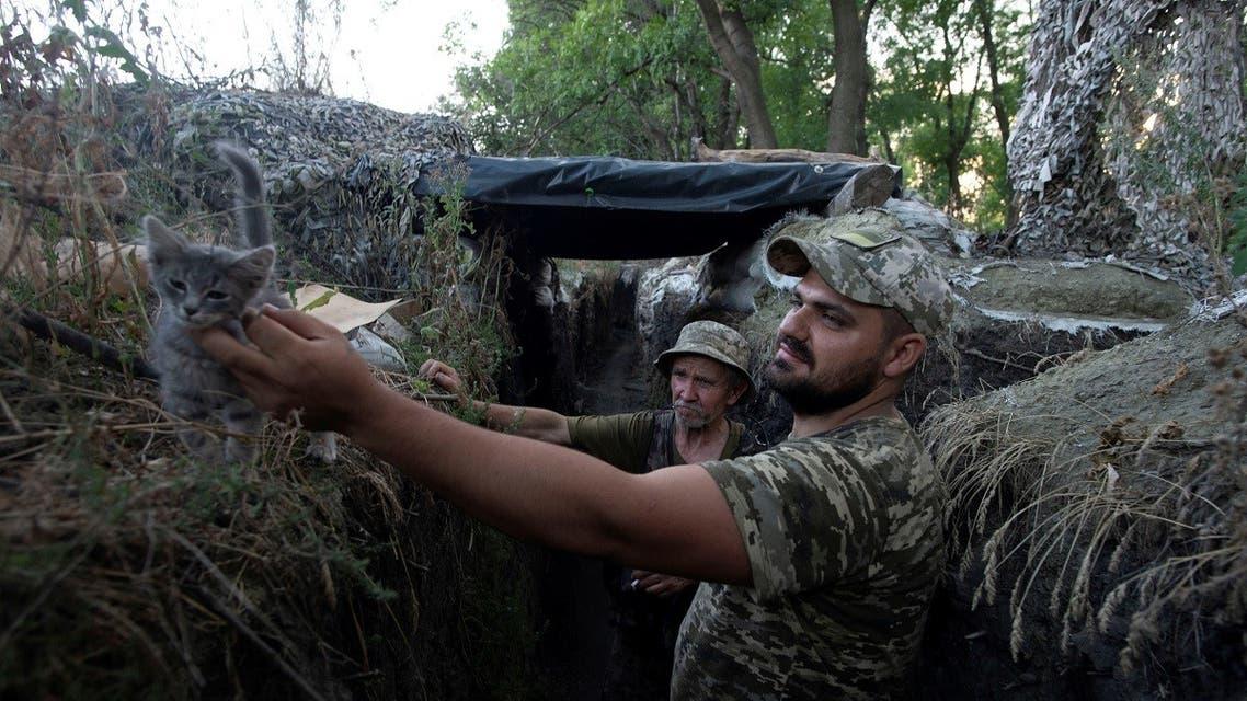 Ukrainian servicemen are seen at a position on the front line near the town of Novotoshkivske in Luhansk region, Ukraine, on July 26, 2020.  (Reuters)