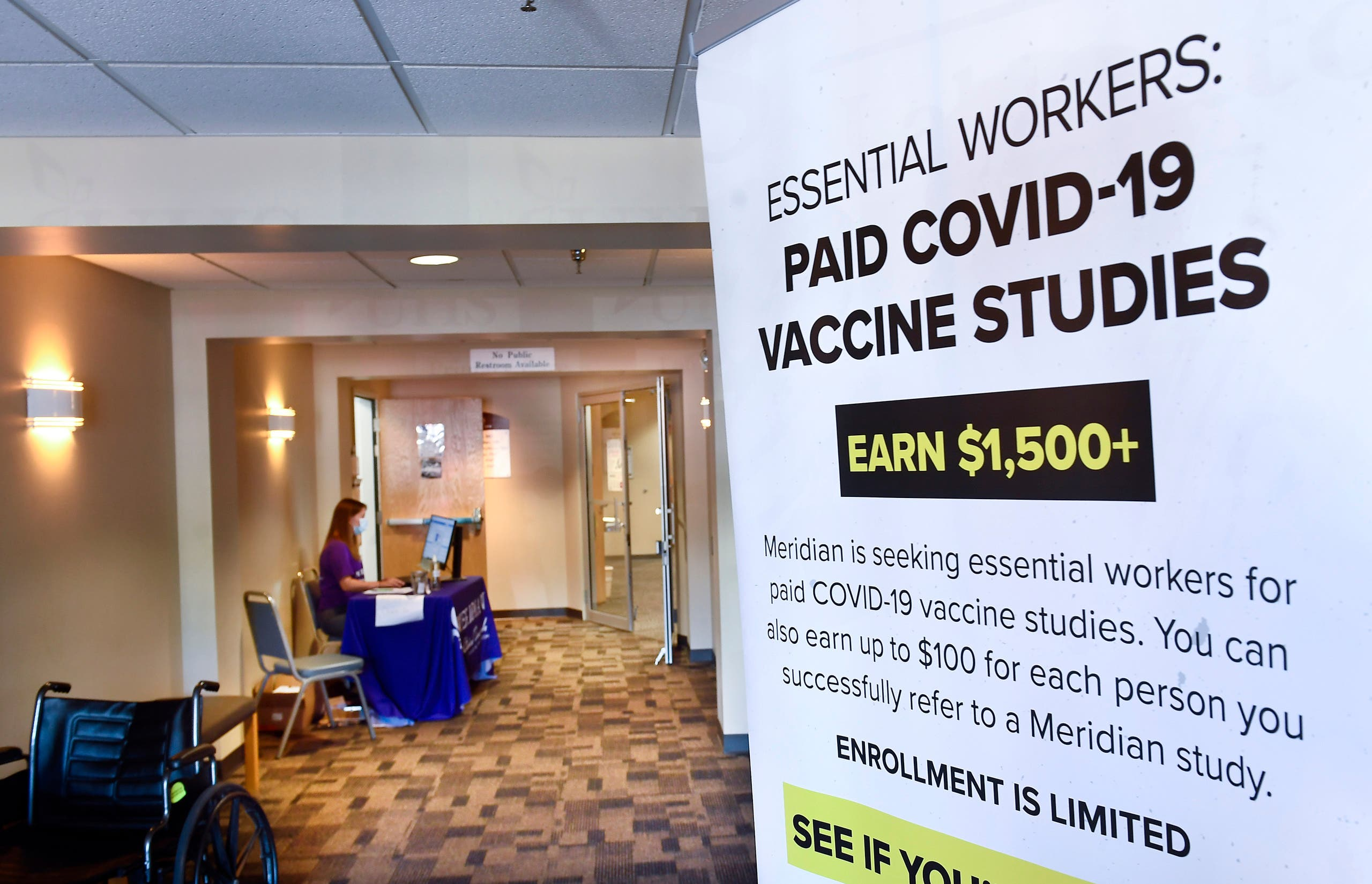 A poster looking for volunteers as the world's biggest study of a possible COVID-19 vaccine, developed by the National Institutes of Health and Moderna , gets underway, July 27, 2020, in Binghamton, NY. (AP)