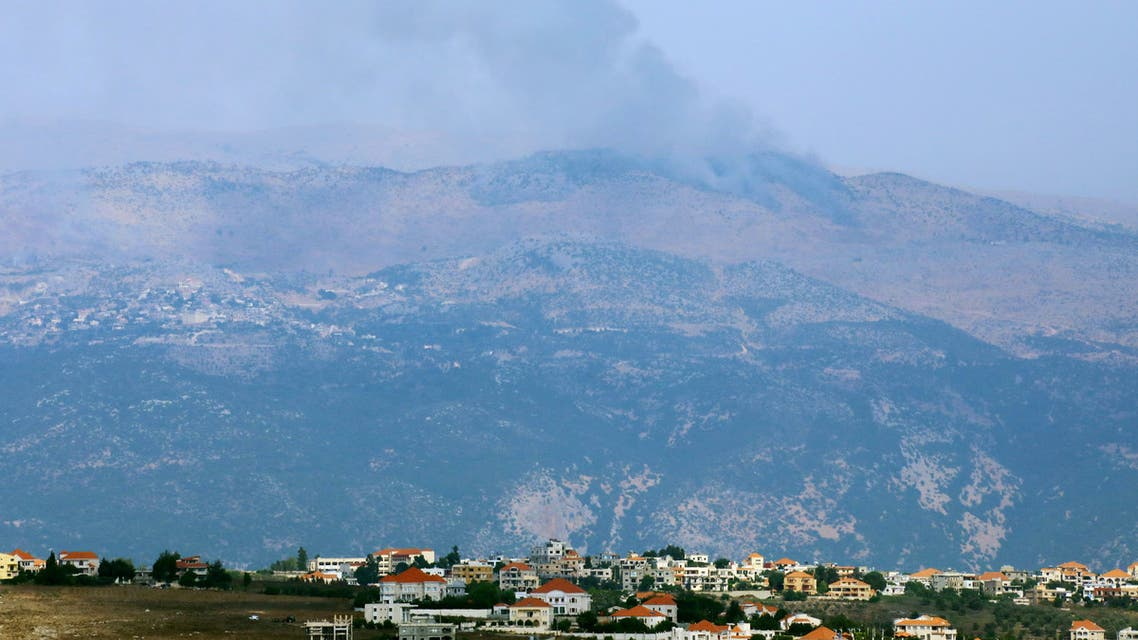 Smoke rises from the disputed Shebaa Farms area as seen from Ibl al-Saqi village in southern Lebanon July 27, 2020. REUTERS/Aziz Taher