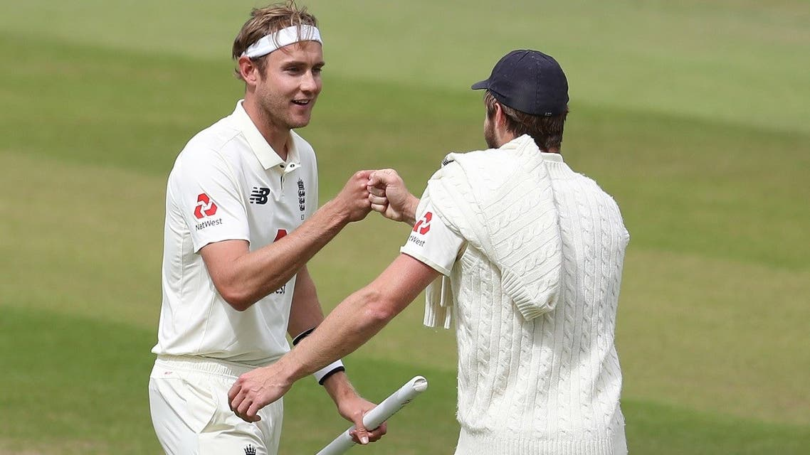 England's Stuart Broad celebrates winning the test series with England's Chris Woakes, as play resumes behind closed doors following the outbreak of the coronavirus disease. (Reuters)