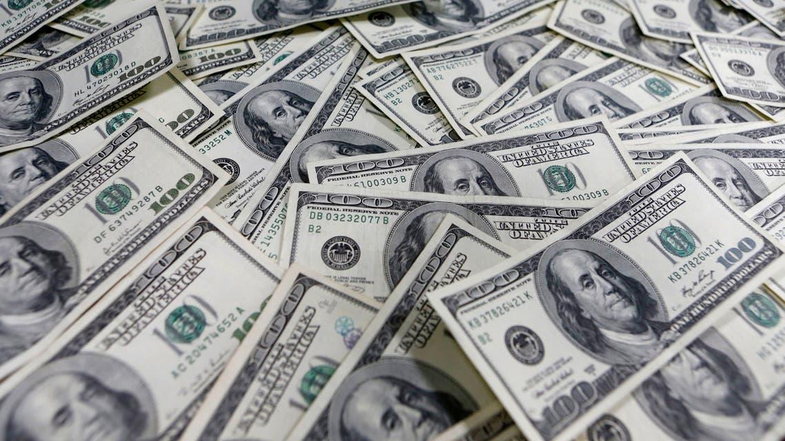 Photo illustration of one hundred US dollar notes. (File photo: Reuters)