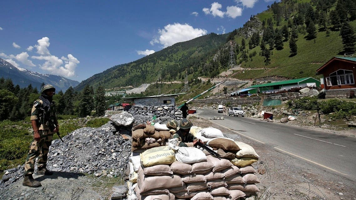 India's Border Security Force (BSF) soldiers stand guard at a checkpoint along a highway leading to Ladakh, at Gagangeer in Kashmir's Ganderbal district on June 17, 2020. (Reuters)