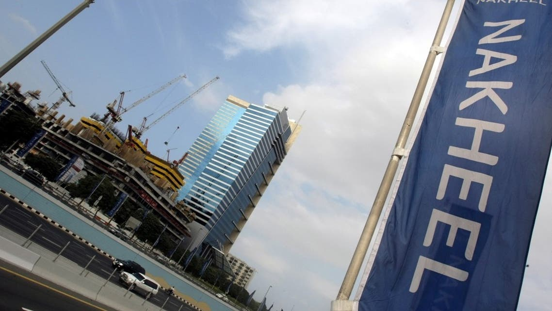 A file photo shows a banner of Dubai's property giant Nakheel flutters near construction sites and skyscrapers in the Gulf emirate of Dubai. (AFP)