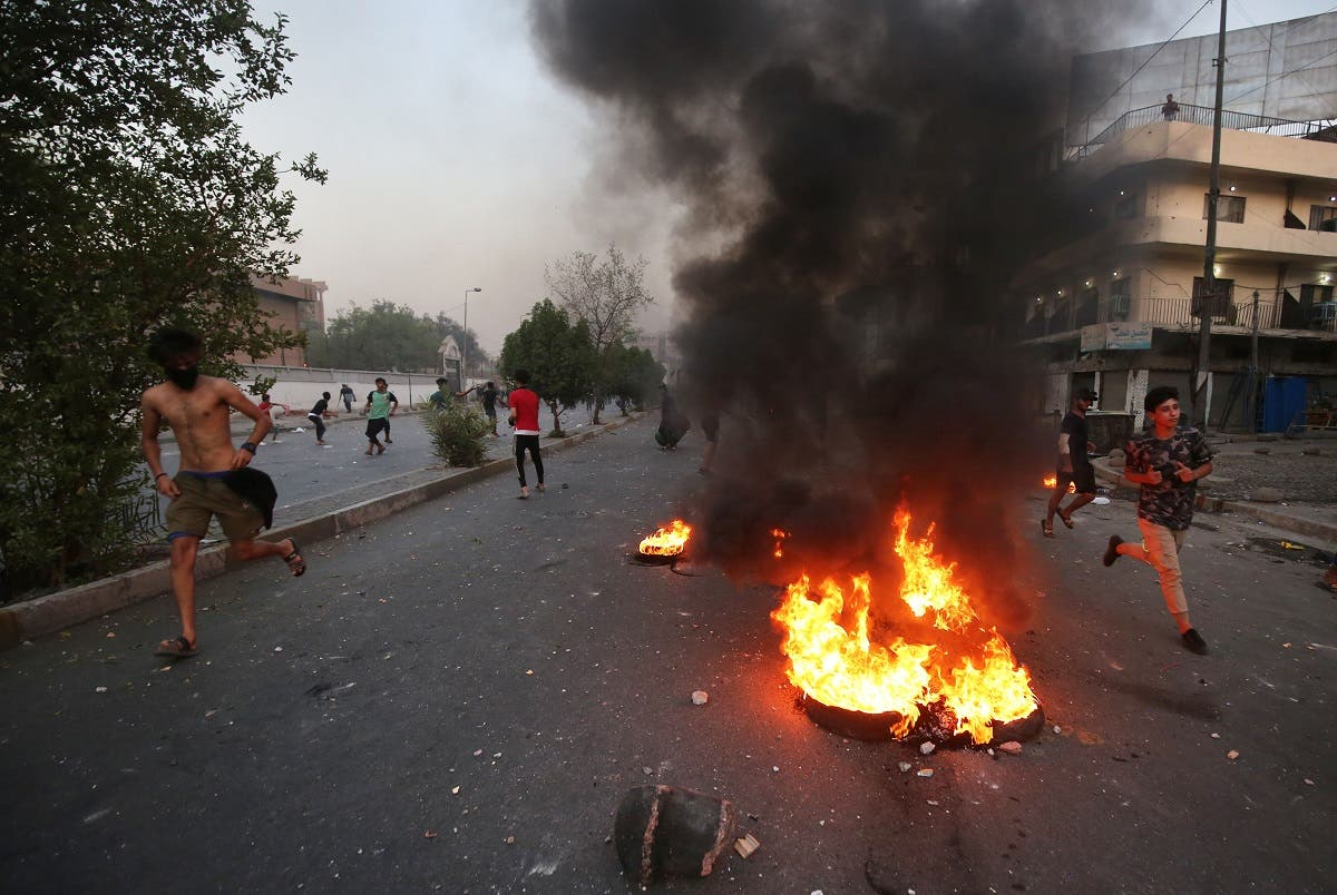 Iraqi demonstrators clash with security forces in al-Tayaran square in central Baghdad on July 27, 2020 during the ongoing anti-government protest due to poor public services. (AFP)