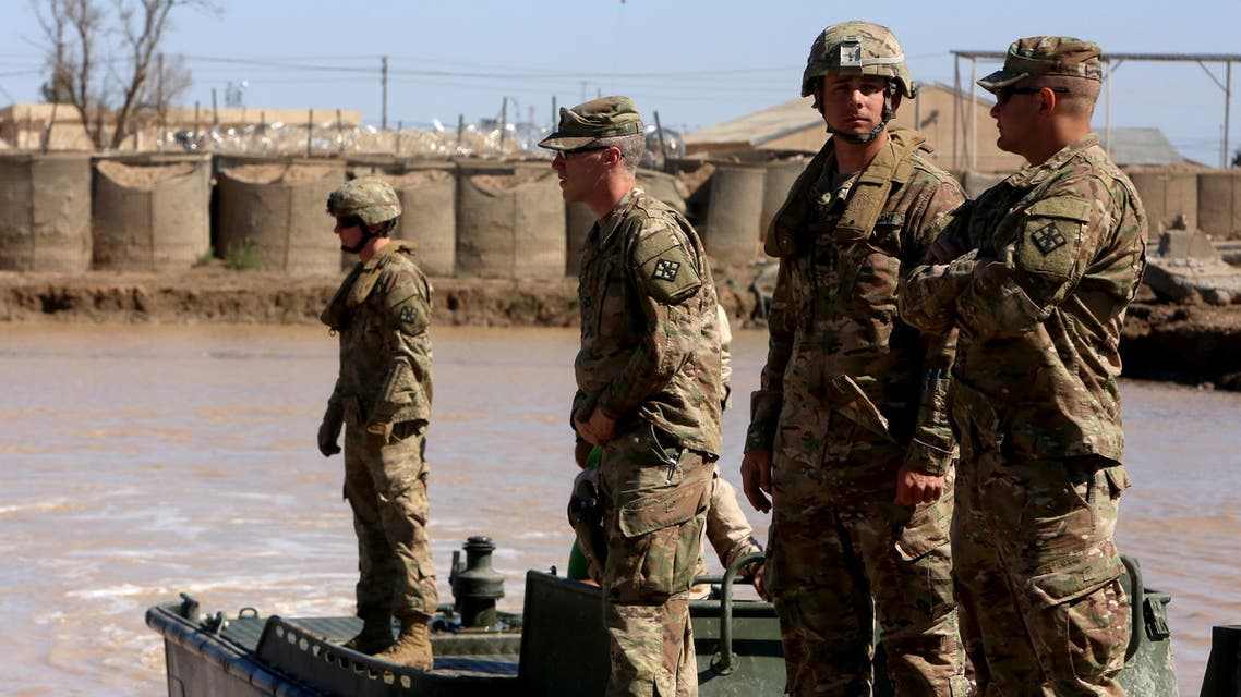 US army forces supervise during a training session at the Taji camp, north of Baghdad, with Iraqi soldiers, aimed at preparing them to install floating bridges, ahead of installing replacement ones in Mosul, on March 6, 2017. Members of the Iraqi army's Bridging Battalion who have completed the training will be deployed in the area of Mosul, where government-led forces are fighting to retake the Islamic State jihadist group's last urban stronghold in the country. Iraqi forces have deployed floating bridges on a number of occasions as they waged war against the jihadists in the Land of the Two Rivers.