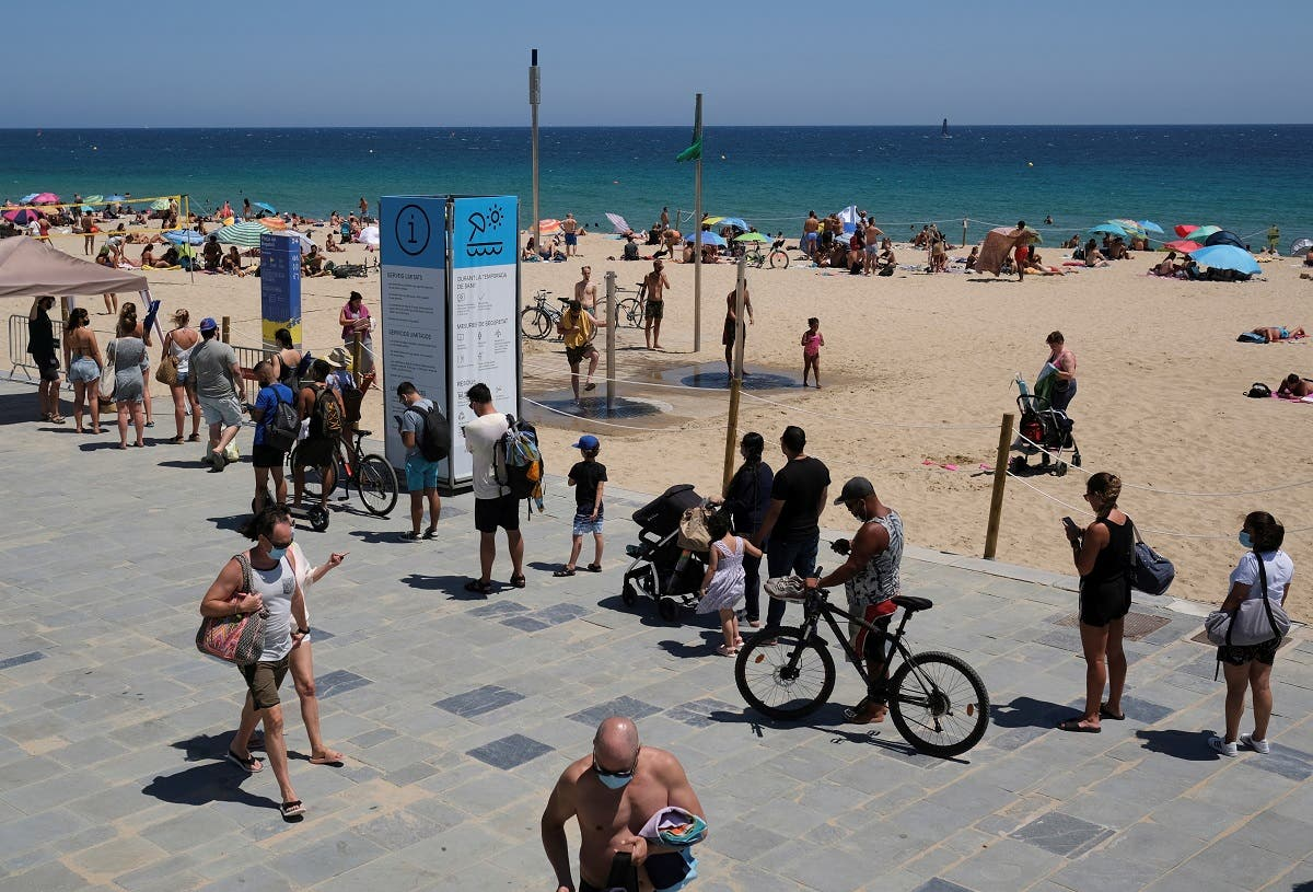People queue to enter the beach, after Catalonia's regional authorities and the city council announced restrictions to contain the spread of the coronavirus in Barcelona, Spain, on July 19, 2020. (Reuters)