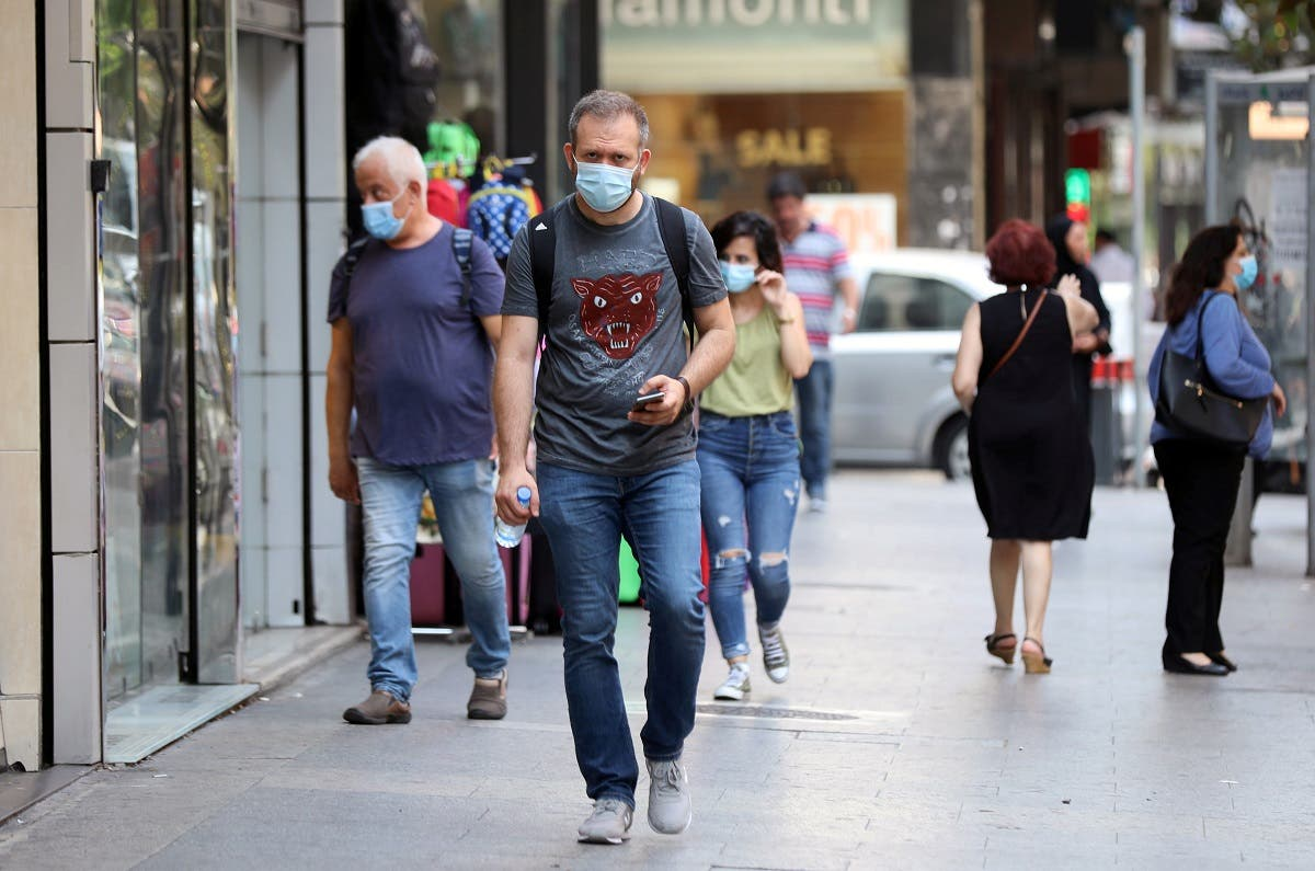 People walk as they wear face masks to prevent the spread of the coronavirus disease (COVID-19) in Beirut, Lebanon. (Reuters)