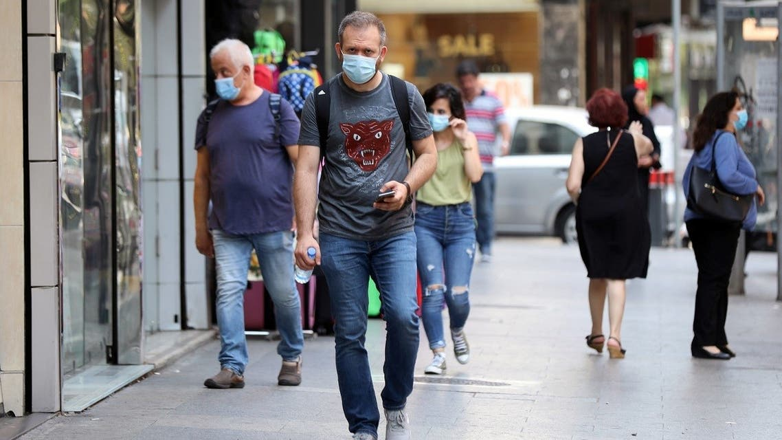 People walk as they wear face masks to prevent the spread of the coronavirus disease (COVID-19) in Beirut, Lebanon July 28, 2020. (Reuters)