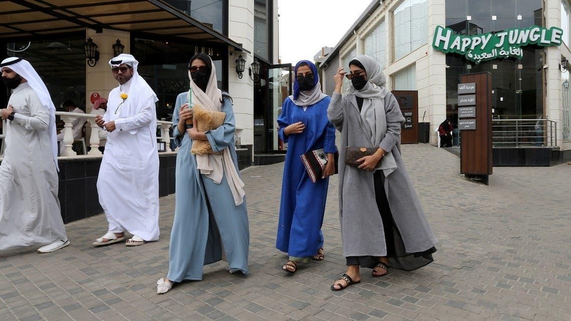 Saudi women walk in Abha High City, as the summer season kicks off with health precautions amid the coronavirus disease (COVID-19) outbreak. (Reuters)