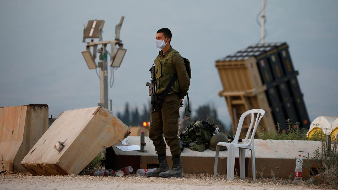 An Israeli soldier stands guard next to an Iron Dome anti-missile system near the Israel's northern border with Lebanon July 27, 2020. REUTERS/Amir Cohen