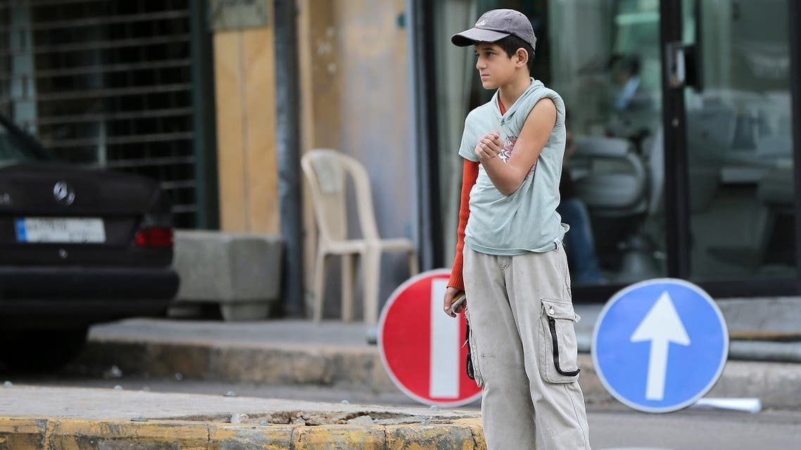 A file photo shows a street child shows a burn on his arm as he begs for money in a street of the Lebanese capital Beirut. (AFP)