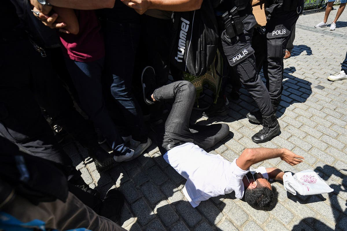 Turkish police scuffle with a small group of faithful trying to enter the overcrowded plaza of the historic Sultanahmet district of Istanbul on July 24, 2020 as thousands of people gather outside Hagia Sophia to perform the Friday prayer. (AFP)