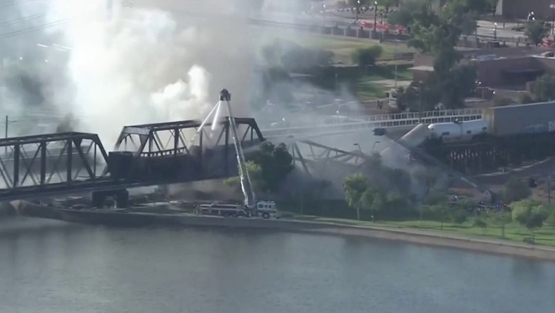 Screengrab image of a derailed train in Arizona that caught on fire and caused a partial bridge collapse. (Screengrab)