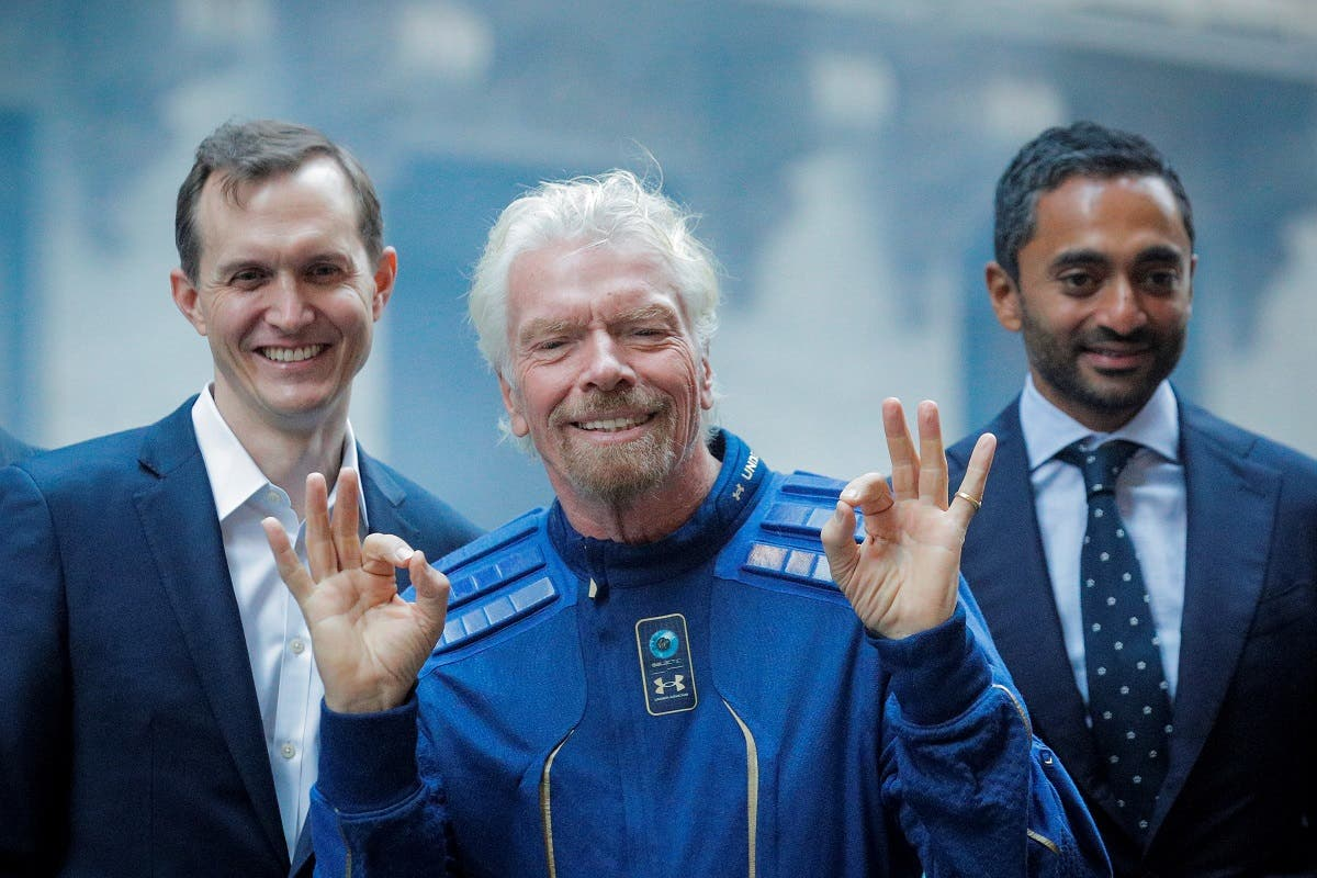 201Virgin Galactic co-founder Sir Richard Branson, CEO George Whitesides and Social Capital CEO Chamath Palihapitiya pose together outside of the New York Stock Exchange (NYSE) ahead of Virgin Galactic (SPCE) trading in New York, US, October 28, 2019. (Reuters)