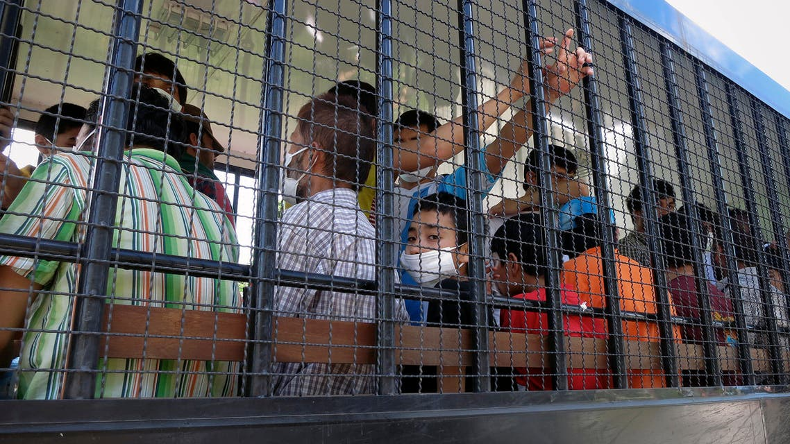 Suspected Uighurs are transported back to a detention facility in the town of Songkhla in southern Thailand after visiting women and children at a separate shelter on March 26, 2014. (Reuters)