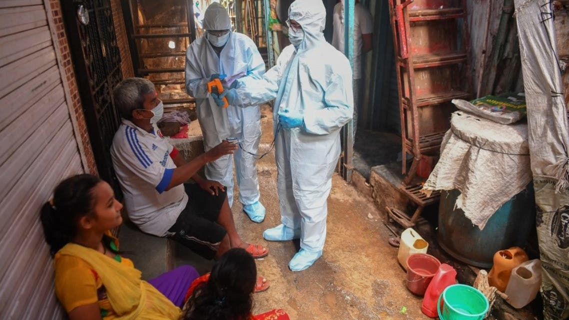 Medical staff wearing Personal Protective Equipment (PPE) conduct a door-to-door medical screening inside Dharavi slums to fight against the spread of the coronavirus, in Mumbai,  June 24, 2020. (AFP)