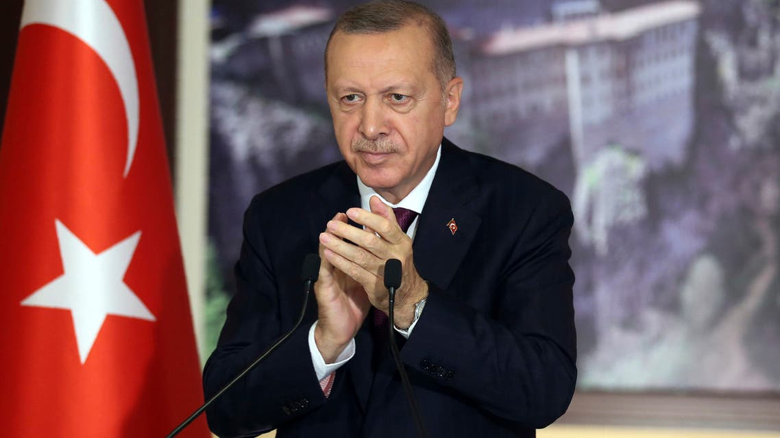 Turkey's President Recep Tayyip Erdogan applauds during a conference in Istanbul on July 28, 2020. (AP)