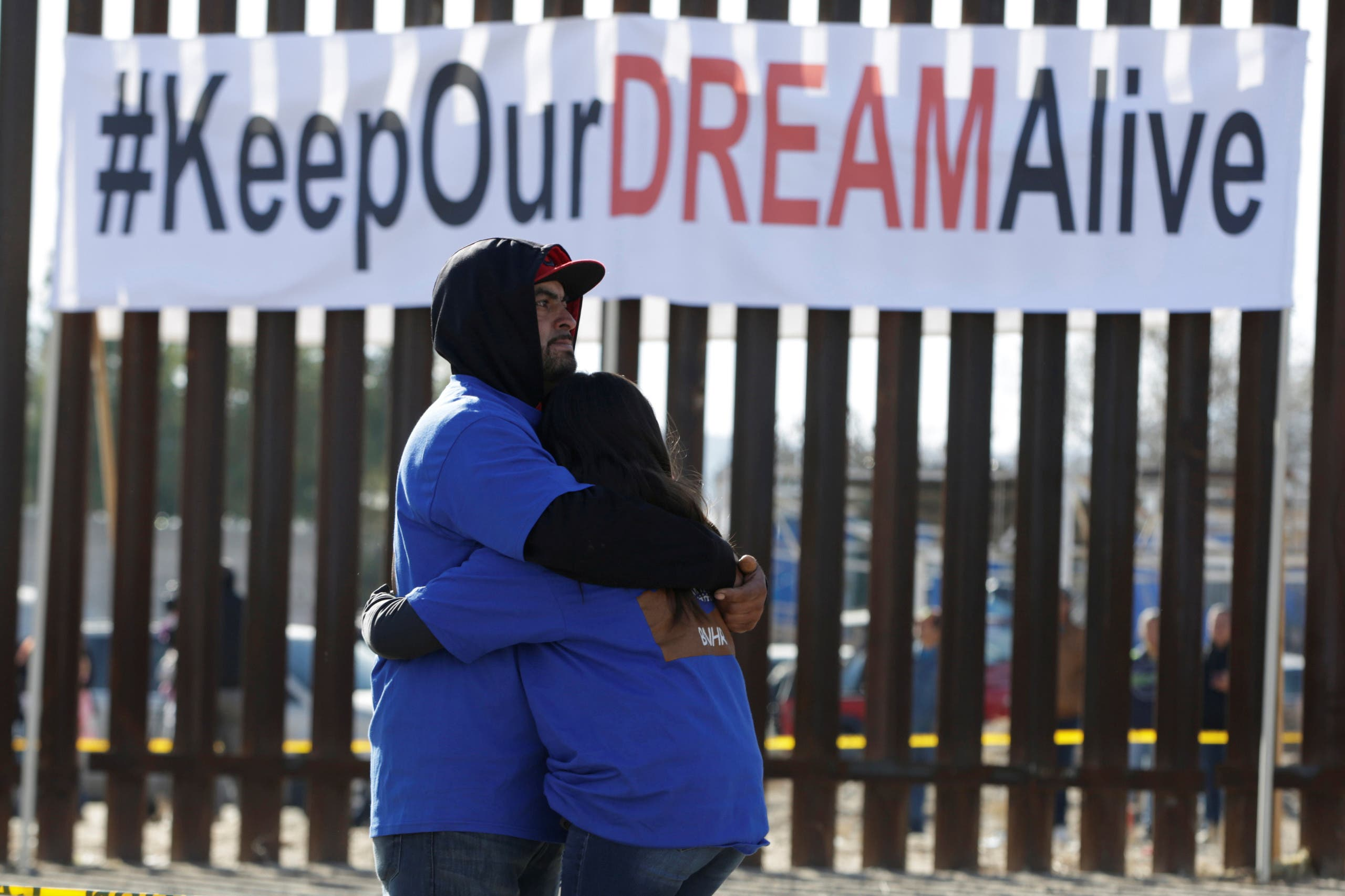 'Dreamers' hug as they meet with relatives during the 'Keep Our Dream Alive' binational meeting at a new section of the border wall on the U.S.-Mexico border in Sunland Park, U.S., opposite the Mexican city of Ciudad Juarez, Mexico, December 10, 2017. (Reuters)