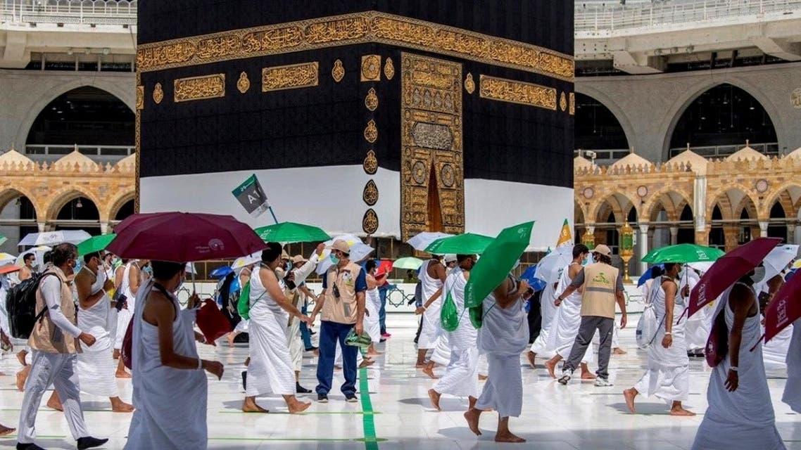 Muslim pilgrims circle the Kaaba at the Grand mosque during the annual Haj pilgrimage amid the coronavirus disease (COVID-19) pandemic. (Reuters)