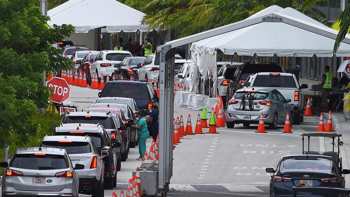 "In this file photo taken on July 22, 2020 cars line up for Covid-19 test at a ""walk-in"" and ""drive-through"" coronavirus testing site in Miami Beach, Florida. (AFP)"