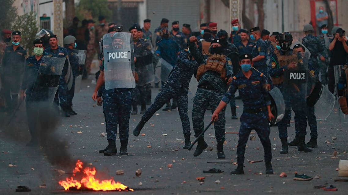 Security forces try to disperse demonstrators during ongoing anti-government protests near Tahrir square, Baghdad on July 27, 2020. (AP)