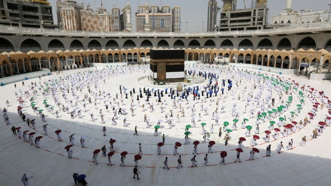 A picture taken on July 29, 2020 shows pilgrims while social distancing as a coronavirus preventative measure while circumambulating around the Kaaba, Islam's holiest shrine, at the centre of the Grand Mosque in the holy city of Mecca, at the start of the annual Muslim Hajj pilgrimage. (AFP)