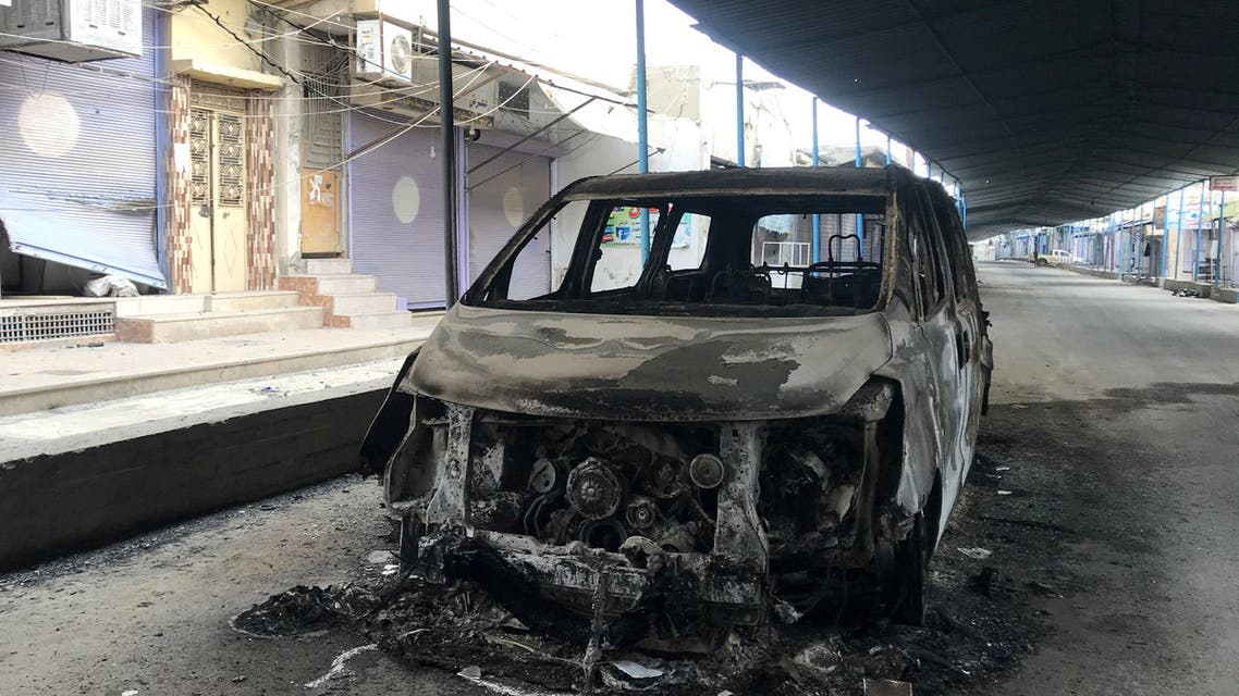 A burnt car is seen along a deserted street in the town of Ras al-Ain, Syria October 24, 2019. (File photo: Reuters)