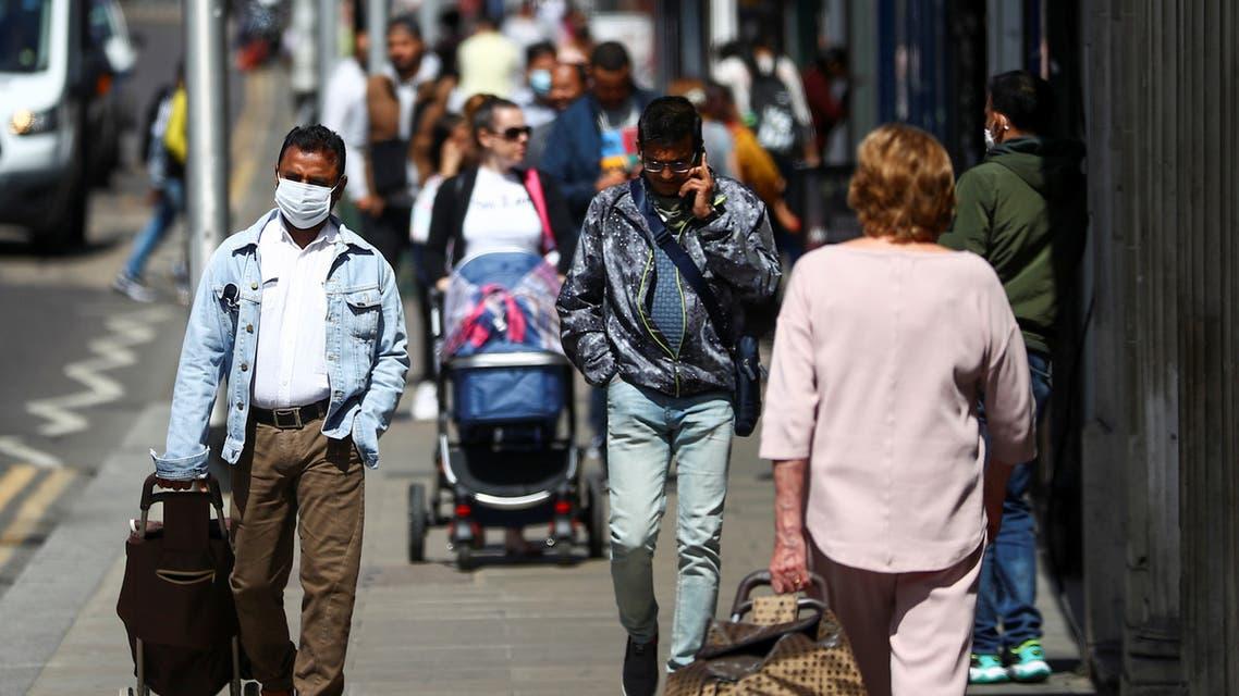 People walk down a street following the coronavirus disease (COVID-19) outbreak, in Ilford, London, Britain July 29, 2020. (Reuters)