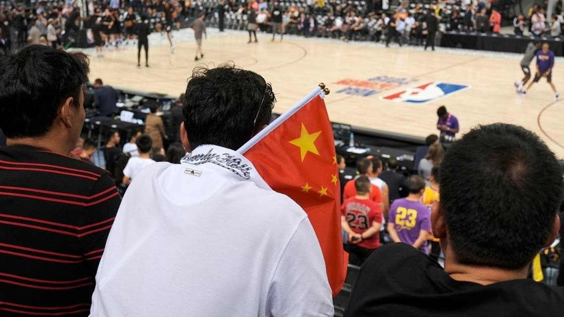 A fan carries a Chinese national flag during an NBA game in China in 2019. (File Photo: Reuters)