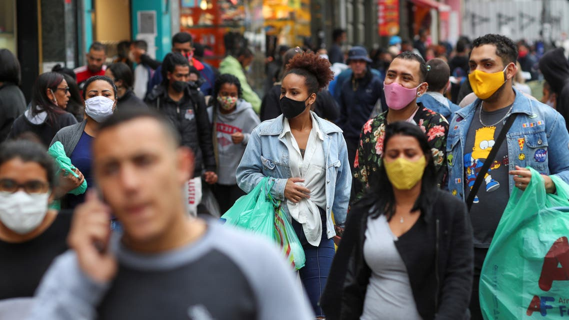 People walk at a popular shopping street amid the outbreak of the coronavirus disease (COVID-19), in Sao Paulo, Brazil, July 15, 2020. Picture taken July 15, 2020. (Reuters)