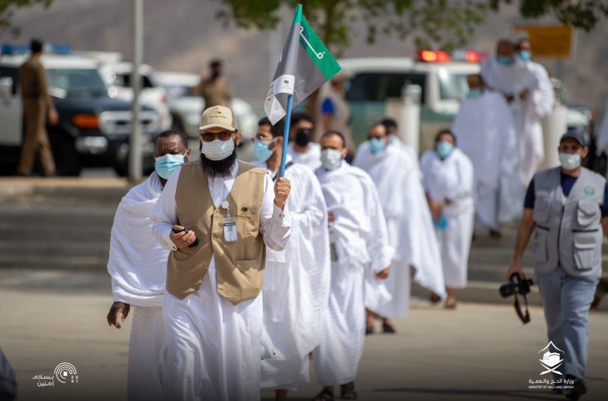 Hajj pilgrims make their way to Mount Arafat amid COVID-19 precautionary measures.. (Twitter)