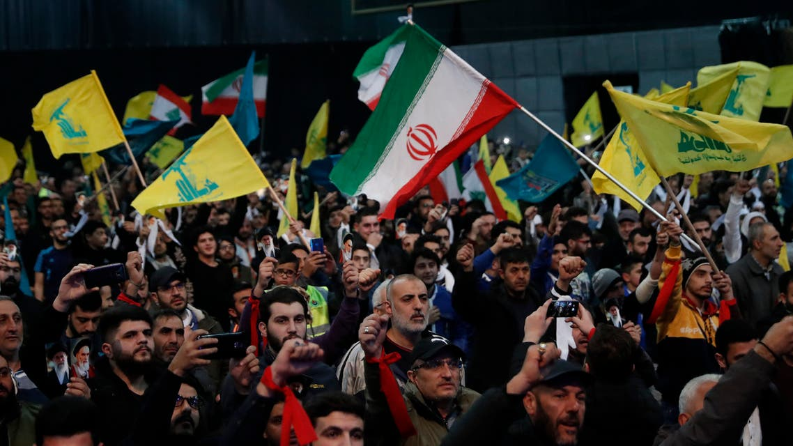 Hezbollah supporters shout slogans and wave Lebanese, Hezbollah and Iran flags, during a rally to commemorate the 40th anniversary of Iran's Islamic Revolution, in southern Beirut, Lebanon, Wednesday, Feb. 6, 2019. (AP)