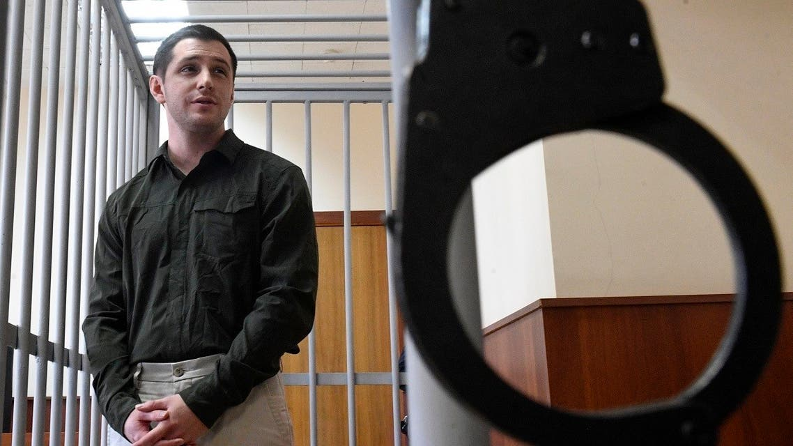 US ex-marine Trevor Reed, charged with attacking police, stands inside a defendants' cage during a court hearing in Moscow on March 11, 2020. (AFP)